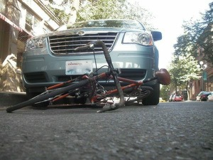 "Take photos of the accident scene ""as is"" to fortify your case. Photo by Bicycle Paper"