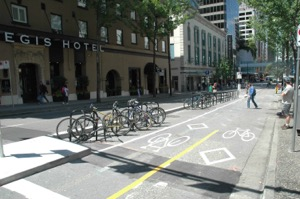 Bike Boulevards, bike corrals, and separation from auto traffic all combined to create a better and safer experience for all.  Photo courtesy of City of Vancouver