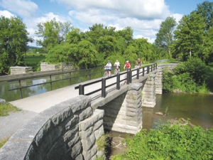 Riding the Erie Canal aqueduct is accessible to all types of cyclists. Photo courtesy of Erie Canalway NHC