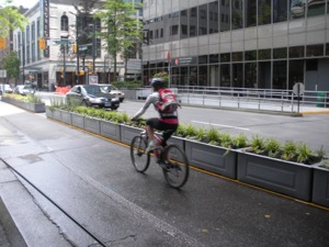 Medians that separate cyclists and motorists don't have to be boring concrete structures. Photo by City of Vancouver