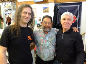 Dan Towle, Angel Rodriguez and Glenn Erickson pose together at R+E Cycles on March 2, 2013. Photo courtesy of R+E Cycles